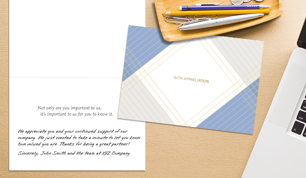 "A card with the words ""With Appreciation"" is open to the inside, which shows a handwriting font message that says, ""We appreciate you and your continued support of our company. We just wanted to take a minute to let you know how valued you are. Thanks for being a great partner! Sincerely, John Smith and the team at XYZ Company."""